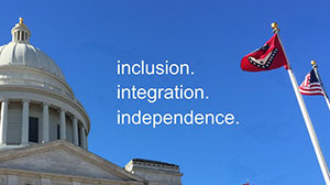 Image of blue sky with the Arkansas State Capitol dome, the words inclusion integration and independence, and the Arkansas State flag and the United States flag.